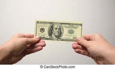 Female hands holding money and showing thumbs up. Woman showing thumbs up holding dollars in hand, well paid job, profit