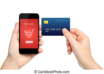 female hands holding phone and credit card making a onlain purch