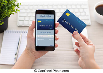 female hands holding phone with mobile wallet for online...