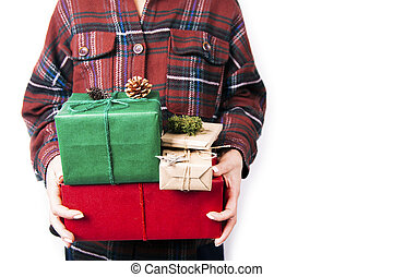 Female hands holding pile of gifts