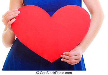 Female hands holding red heart love