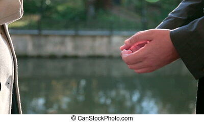 Female hands in the hands of men