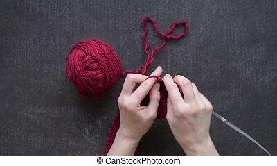 Female hands knitting