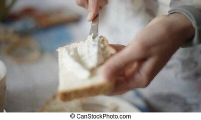 Female hands making a cheese sandwich. - Female hands making...