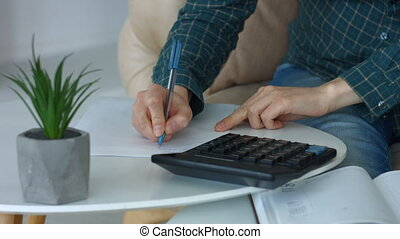 Female hands making calculations on calculator - Closeup ...