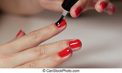 Female hands manicure with red nails close up view on white background. Classic color manicure.