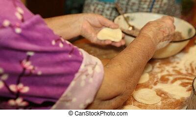 female hands mold dumplings, close-up, HD