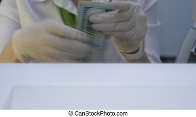 Loan in Dollars. Bundle of 100 Dollar banknotes in Debt. One Hundred Dollars Bills are Stacked in a Bundle Puts On Cash Department Window. Money on Loan During Economic Crisis Caused pandemic Covid-19
