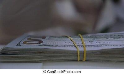 Wads of US. Bank Clerk Gives Lend of Dollar. Employee Puts Bundles of Money on Cash Department Window. Exchange Money. Banker Hands. Teller Works in Protective Gloves. Cash Withdrawal