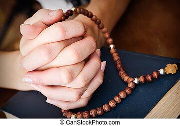 female hands praying