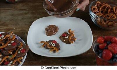 Female hands preparing Christmas chocolate cookies