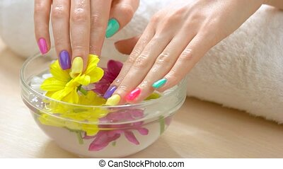 Female hands receiving spa therapy. Young woman hands with...