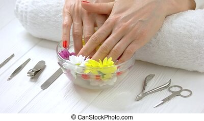 Female hands receiving spa therapy. Young woman hands in...