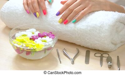 Female hands receiving spa treatment. Female hands with...