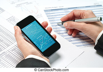 Female hands reviewing accounting on smart phone.