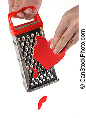 Female hands rubbing heart on a kitchen grater - Female...