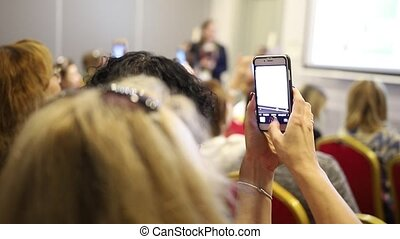 Female hands shooting on the phone awards ceremony, close up