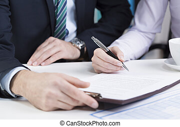 Female hands signing contract