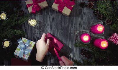 Female hands tying gifts to celebrate New Year