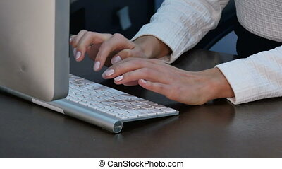 Female hands typing at office. Close up. Professional shot...