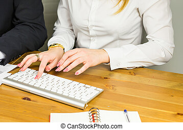 Female hands typing on a laptop close up