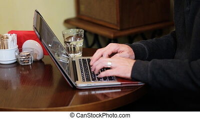 Female hands typing on the notebook