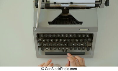 Female hands typing on typewriter