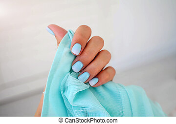 Female hands with a beautiful gentle manicure.
