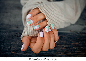 Female hands with beautiful gentle manicure