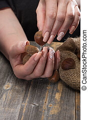 Female hands with beautiful magnificent manicure shift...