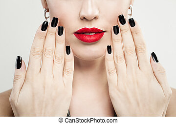 Female Hands with Black Nails Manicure and Red Makeup Lips Closeup