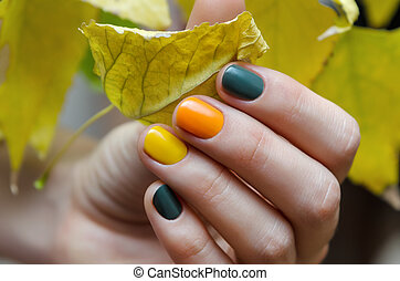 Female hands with color nail design.
