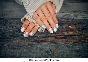 Female hands with gentle nail design.
