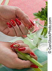 Female hands with manicure hold a jug water and greens -...