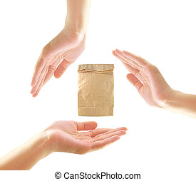 Female hands with paper bag in recycle concept