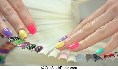 Female hands with perfect summer manicure. Young woman hands...