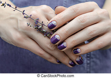 Female hands with purple nail design. - Female hand with...