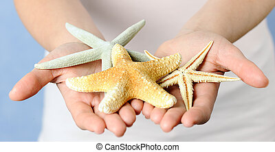 hands with starfishes