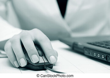 Female hands working on laptop