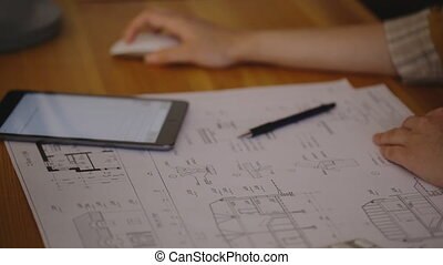 warm light tube, Video blueprint, pencil drawings, tablet-known brand, and in the background a woman's hand, rabotayutschaya mouse scroll that is in the workplace. It traced the drawings home with cuts, numerical values and volumes, format A3 blueprint sheet without notes.