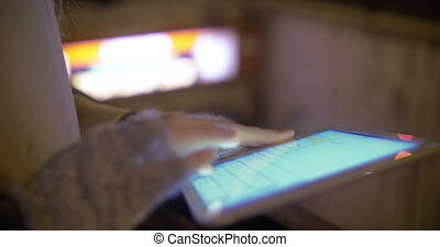 Female hands working with touch pad by metro entrance