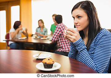 Female having coffee and muffin at  the coffee shop