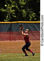Female High School Softball Player Catches Fly Ball