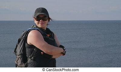 Female hiker at the seaside