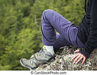 Female hiker body on the mountain rock