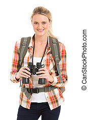 female hiker holding binoculars