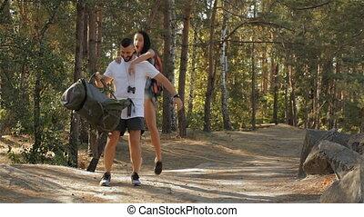 Female hiker jump on the back of her boyfriend