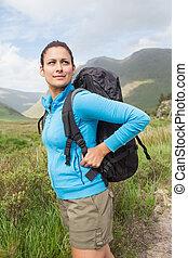 Female hiker looking away