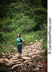 Female hiker on a rugged rustic trail in Costa Rica - Female...