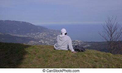 Female hiker resting on top of a mountain Ai-Petri